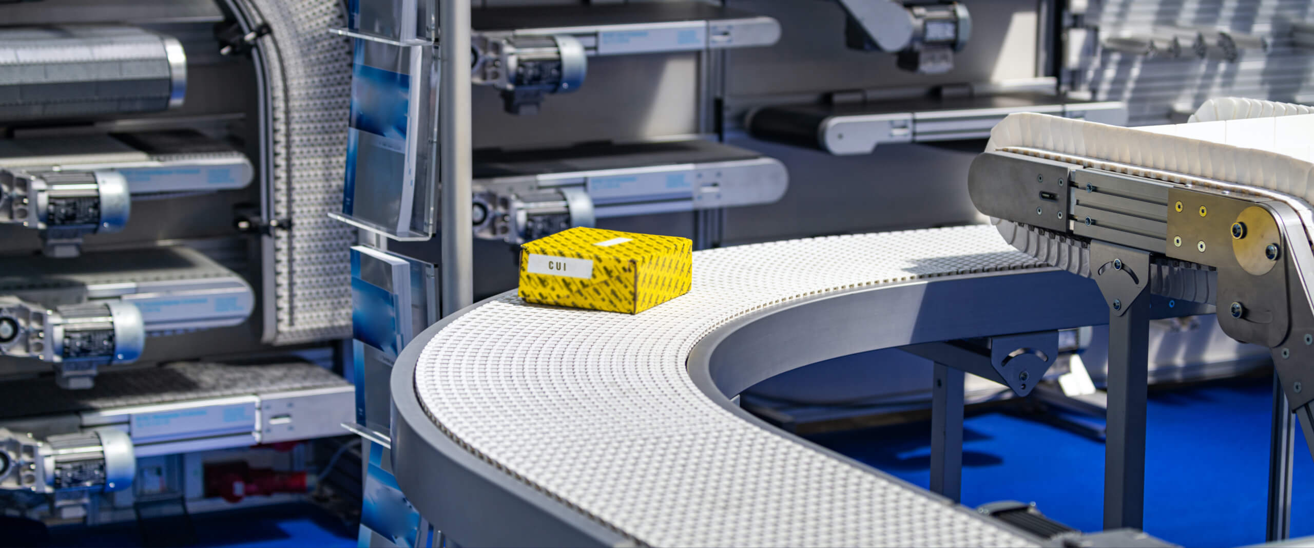 Yellow box on conveyer belt in a factory setting