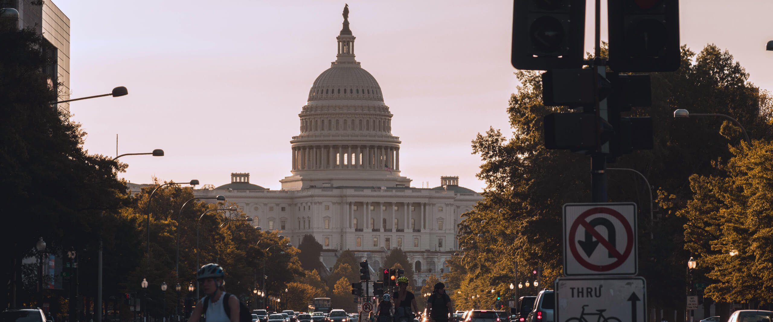 Photo of the U.S. Capitol building with a streetlight and